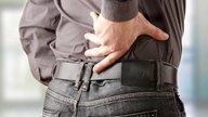Qué puede causar dolor de espalda y en el abdomen (y qué hacer)